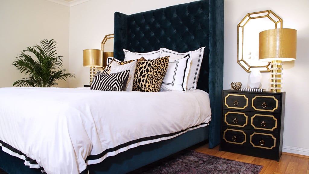 interior design with navy blue headboard and leopard print pillows