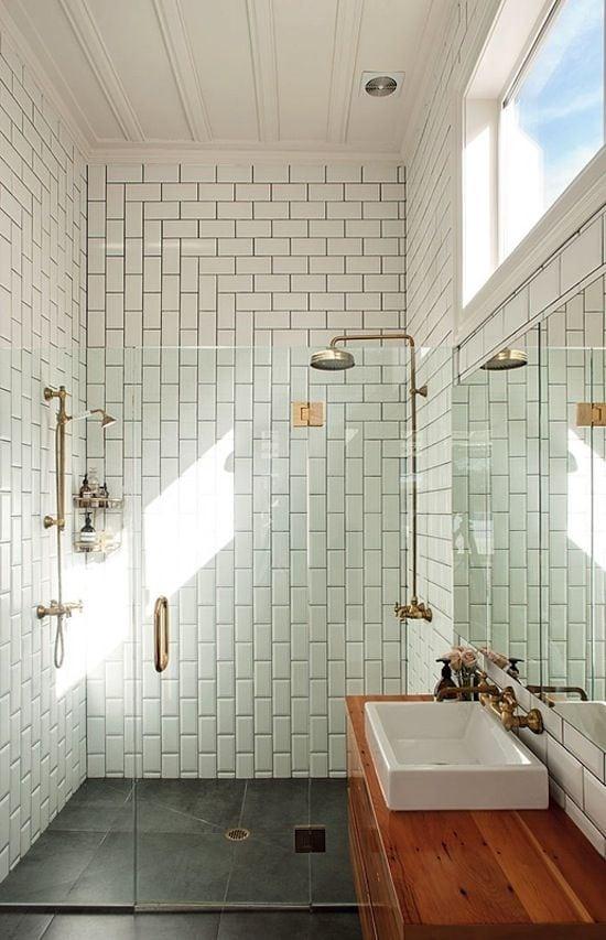 corner white subway tile for bathroom