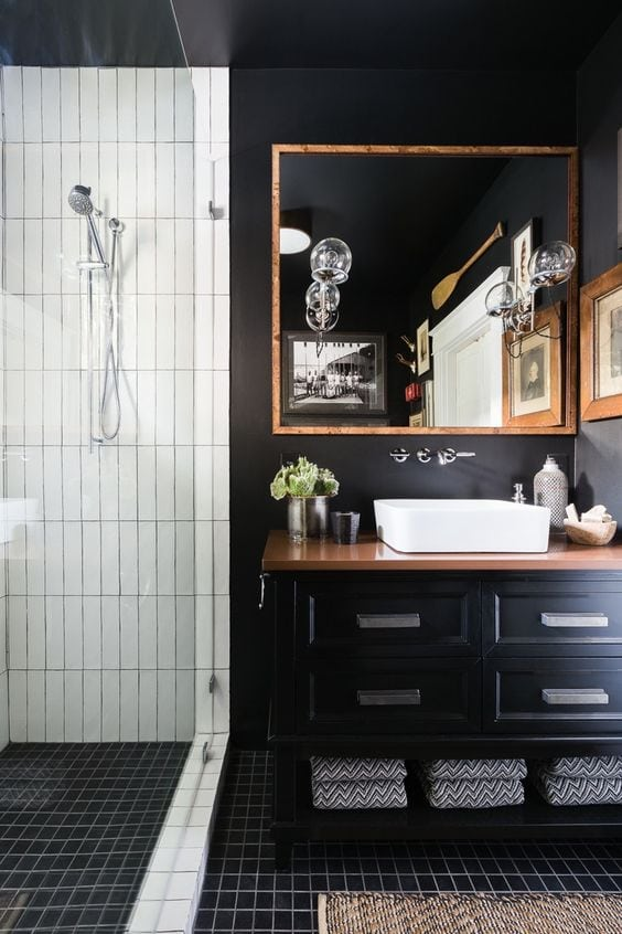 vertically placed white subway tile in a shower