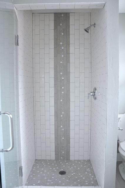 white and grey subway tile for a bathroom