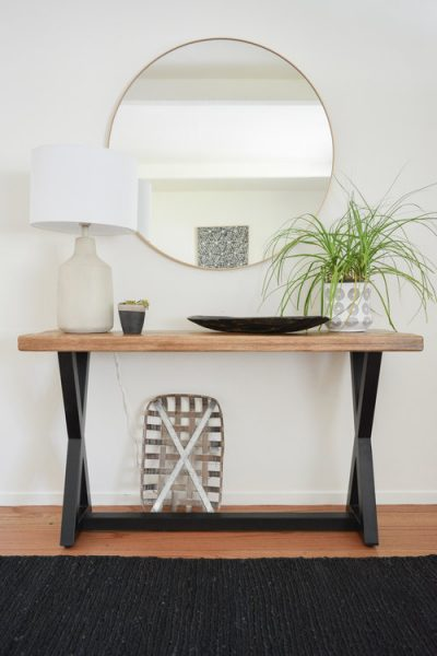 entryway, console table, round mirror