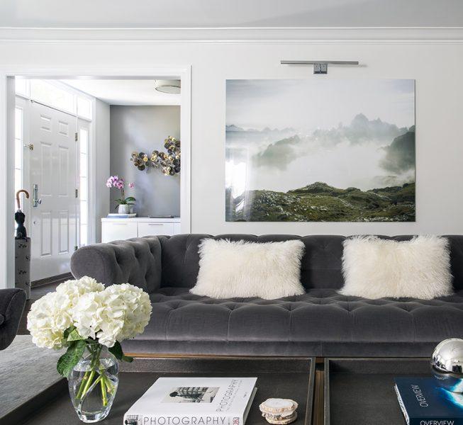 dark grey tufted sofa
