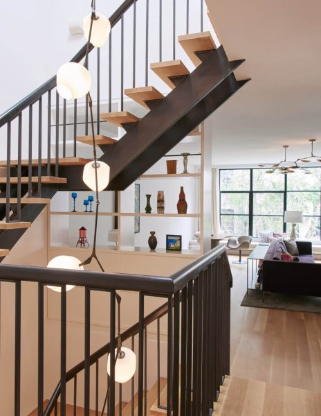 lindsey adelman branching lighting hanging down stair