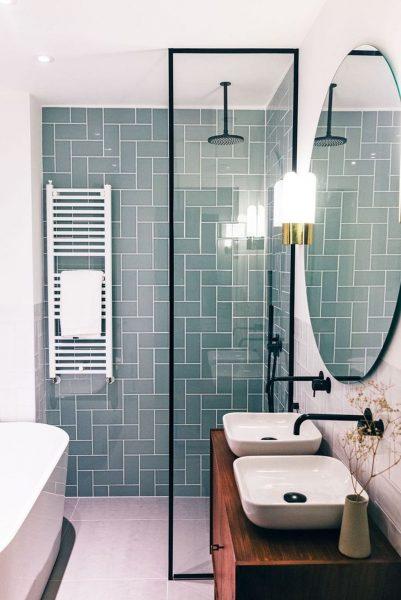 bathroom tile, shower tile, vessel sink, wall mounted fixtures