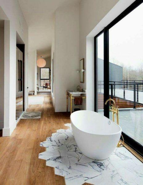 freestanding tub, freestanding tub faucet, gold faucet, cast iron tub, acrylic tub