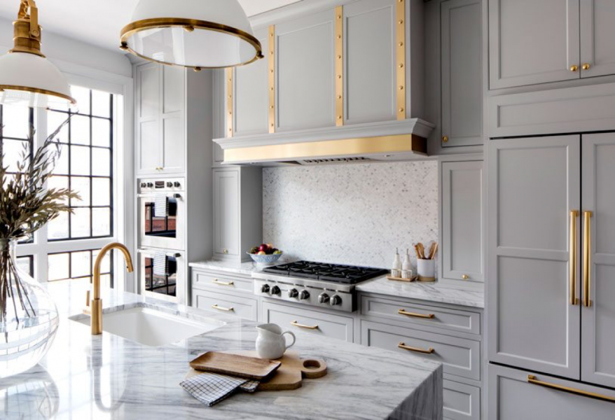grey kitchen cabinets with brass