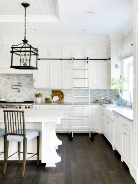 white kitchen with sliding ladder